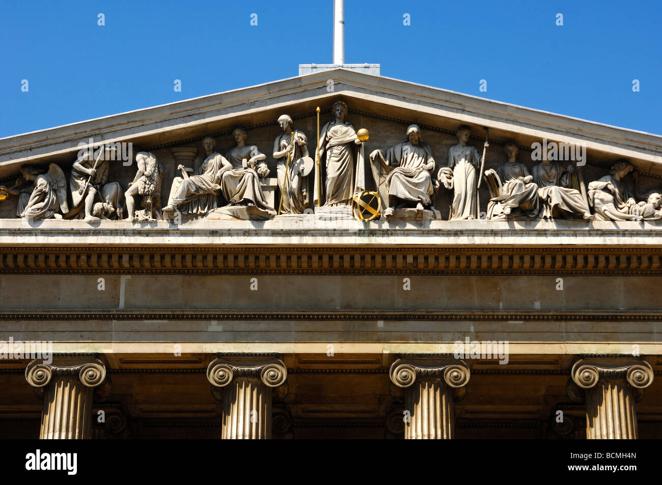 British Museum pediment with allegorical figures over the main entrance, London, United Kingdom - Stock Image