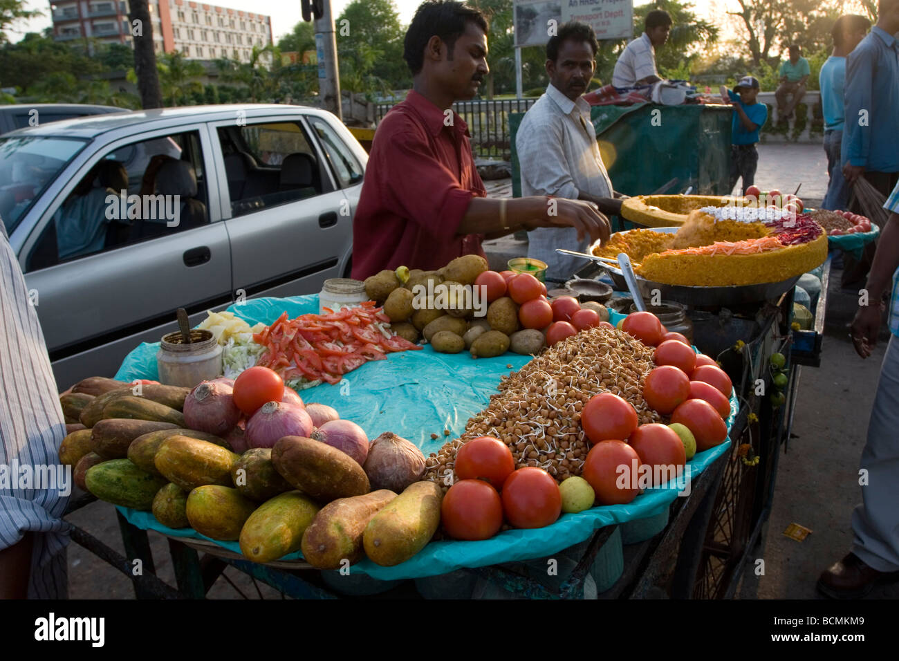 A fruit seller sells fruit openly in the street of Kolkata,West Bengal,India - Stock Image