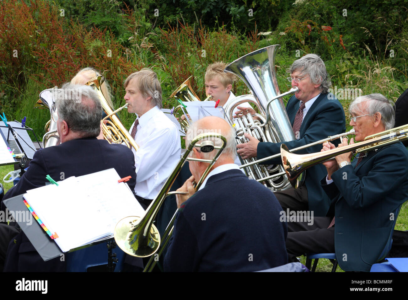 A brass band playing at an English village fete. - Stock Image