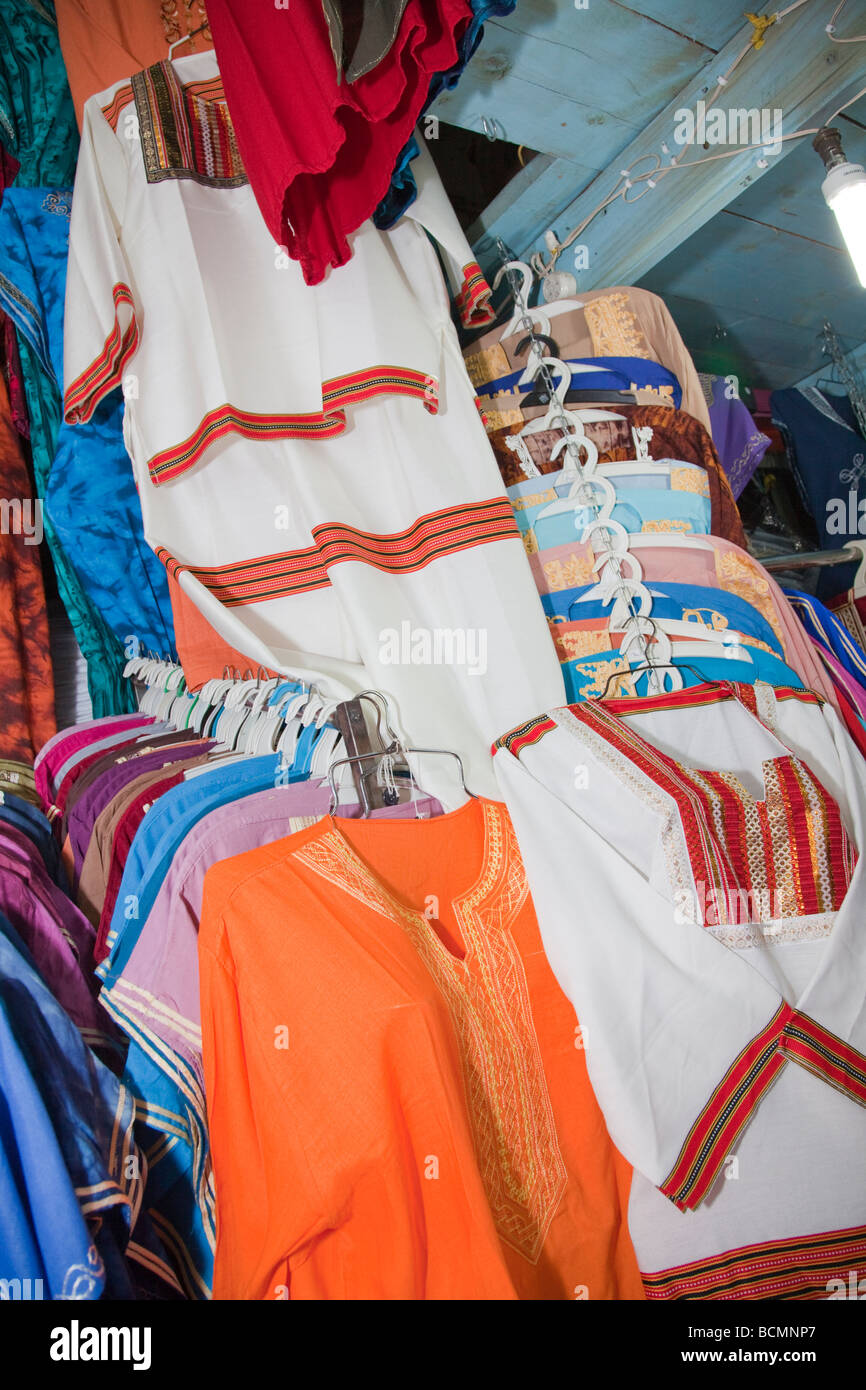 A shop in the Tunis Medina (old city) displays racks of tunics and other clothes in typical Arab style. - Stock Image