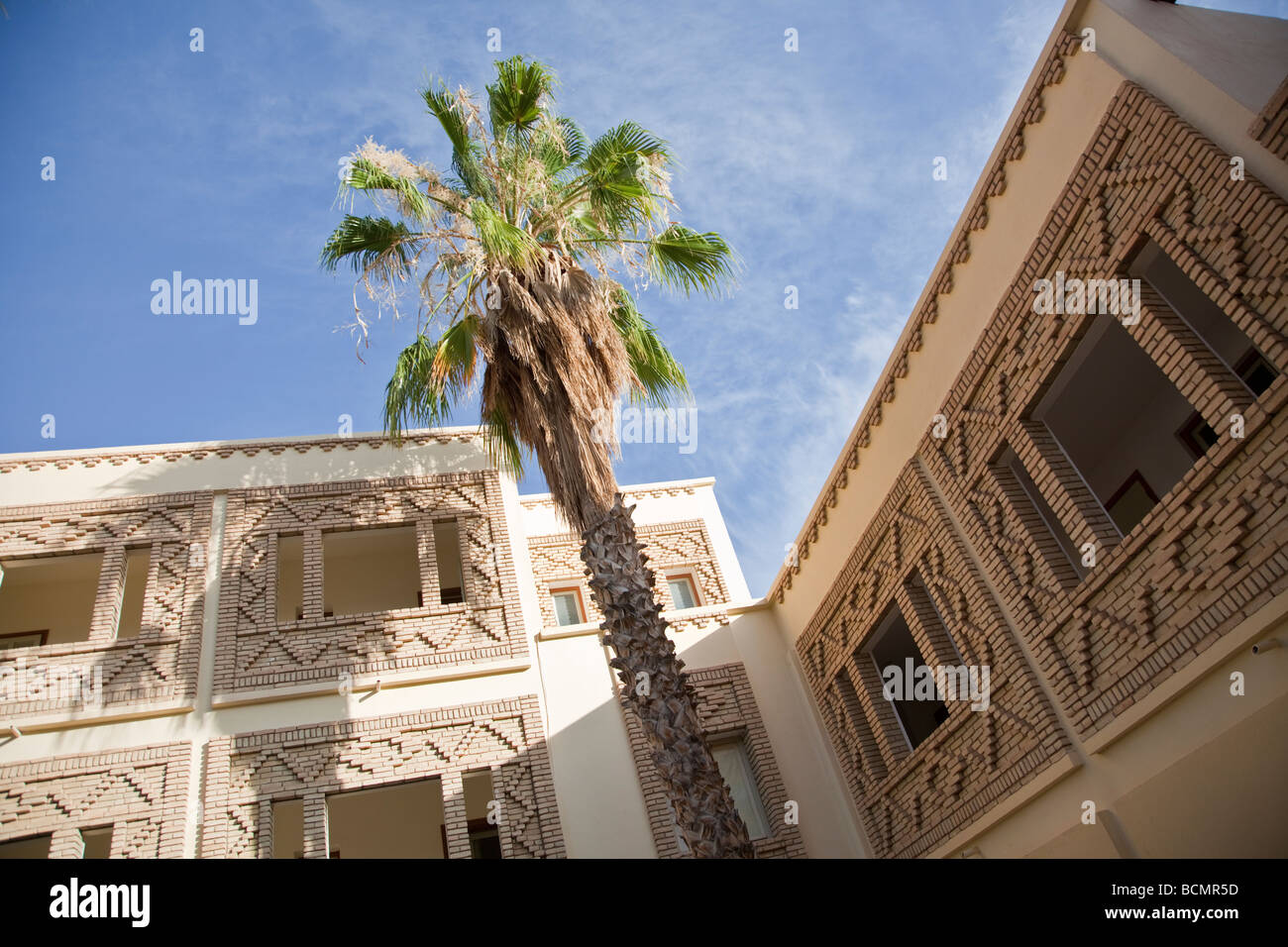 The respectable Hotel de l'Oasis in Tozeur, Tunisia displays the city's traditional and unique brickwork - Stock Image