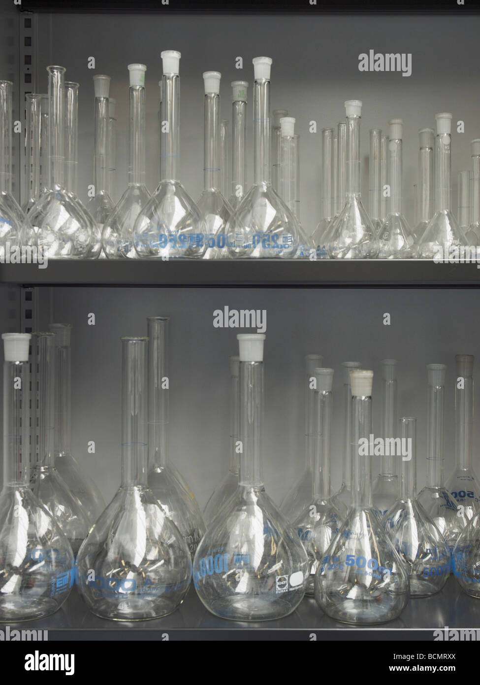 closet with lots of glass lab containers glassware stored on shelves in hospital laboratory Tilburg the Netherlands - Stock Image