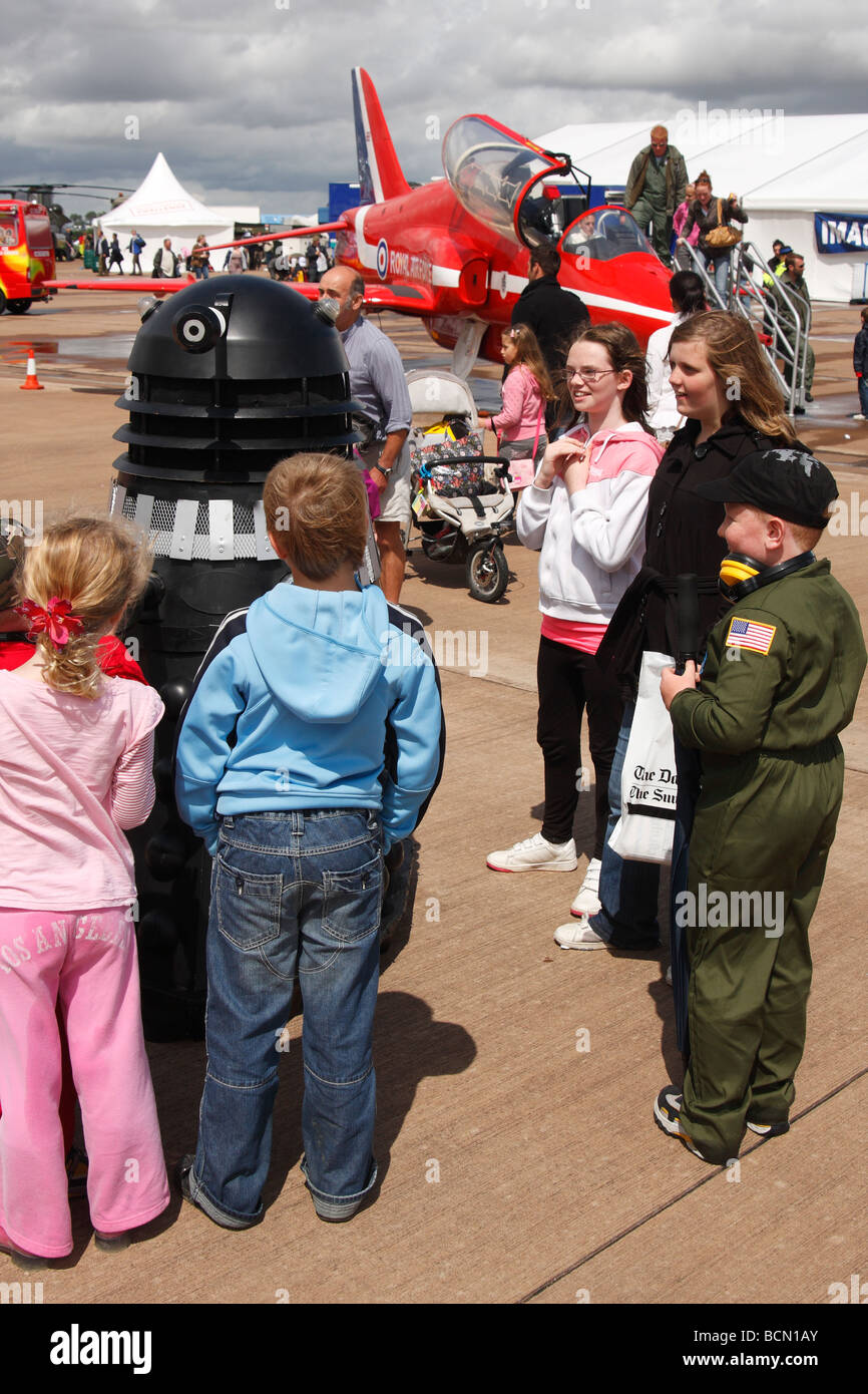 Children playing with model Dalek at 'air show', [RAF Fairford], England, UK - Stock Image