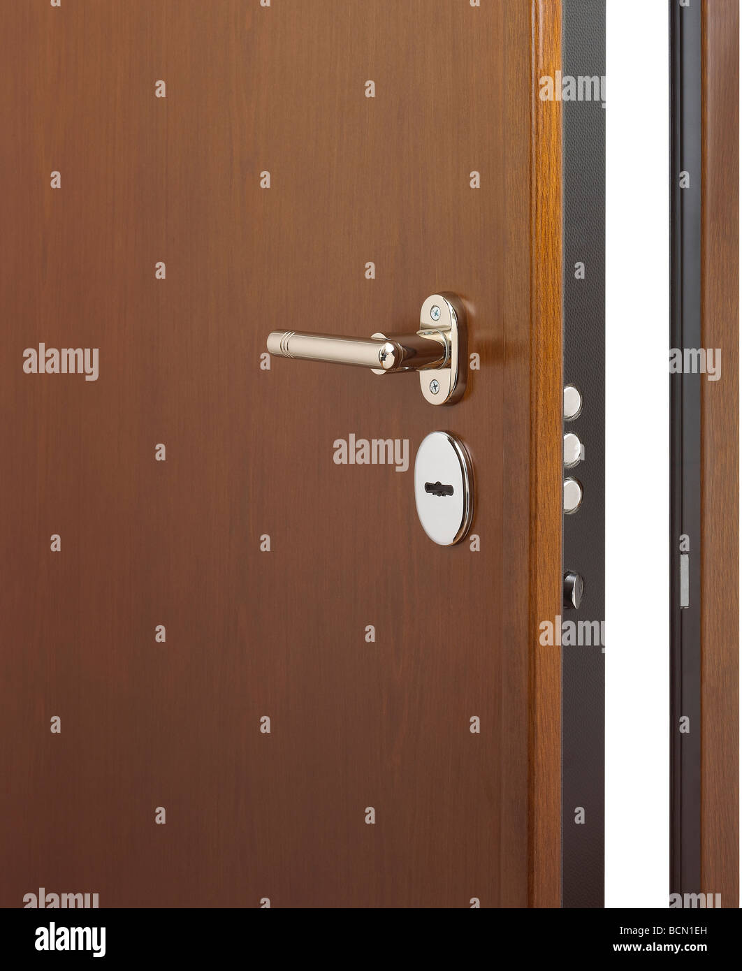 A half opened secure door on white background. - Stock Image