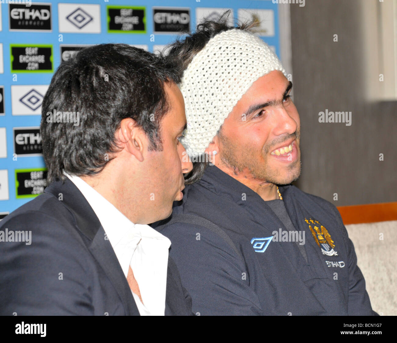 carlos tevez with interpreter at press conference when he signs for manchester city - Stock Image