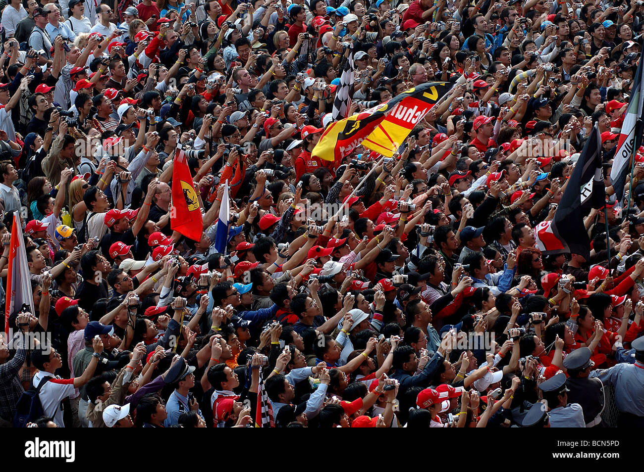 Audience taking photo in Shanghai Circuit for Formula 1 racing in Shanghai, China - Stock Image