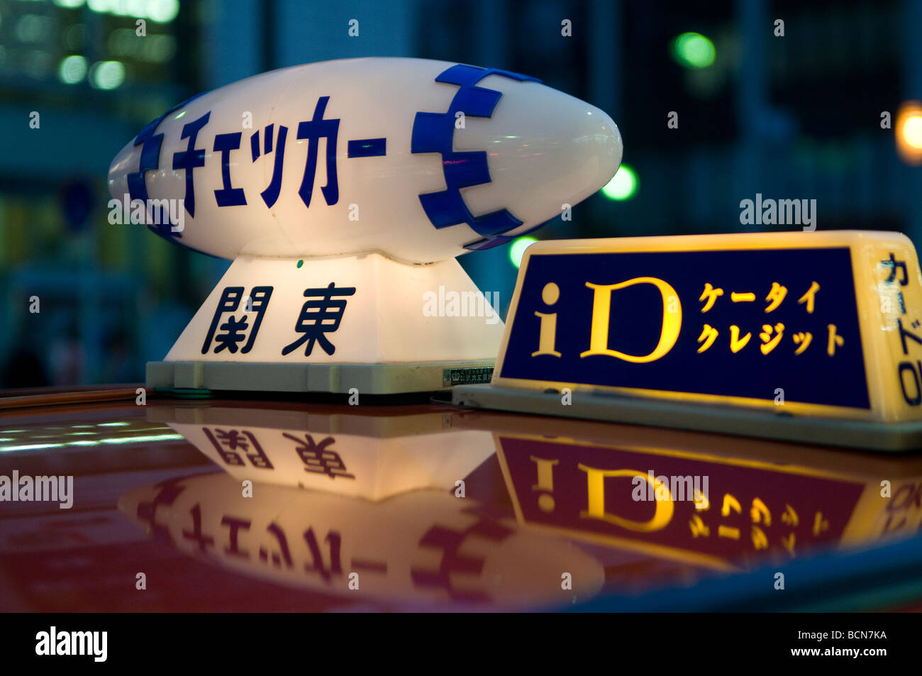 Illuminated taxicab toplight sign in Tokyo Japan - Stock Image
