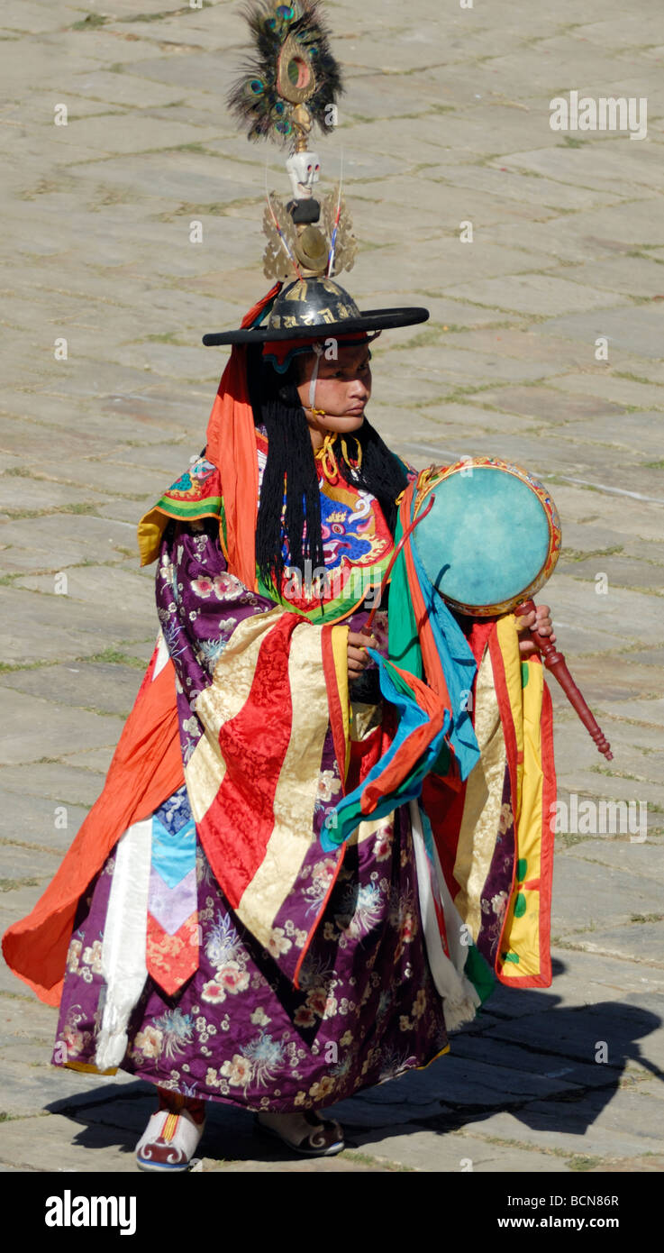 A black hat dancer dressed in gorgeous silk robes spins across the courtyard of Mongar Dzong.Stock Photo