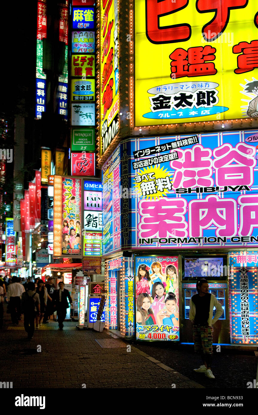 Neon lights and advertisement signs cover building facades