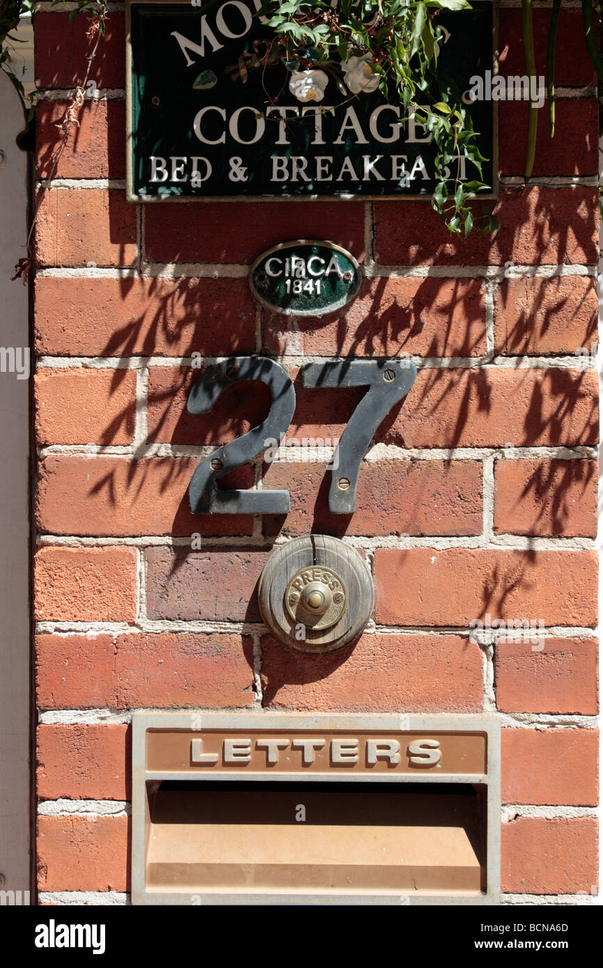 Gatepost of bed and breakfast cottage with doorbell number and letterbox in Guildford Western Australia - Stock Image