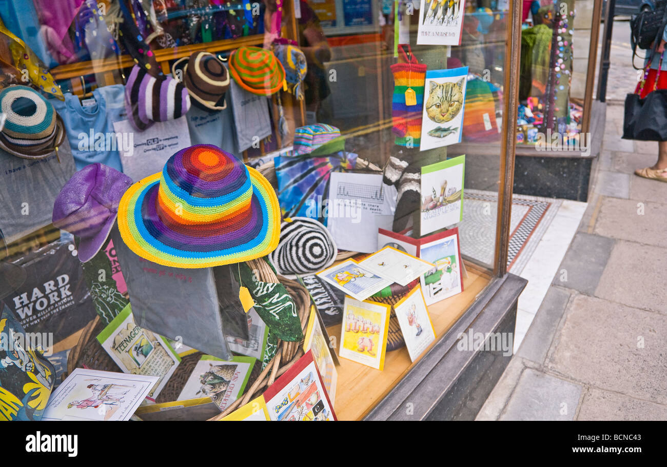 Colourful novelty hats, gifts and cards on display in a shop window. Seaside town of Swanage, Dorset. UK. Stock Photo