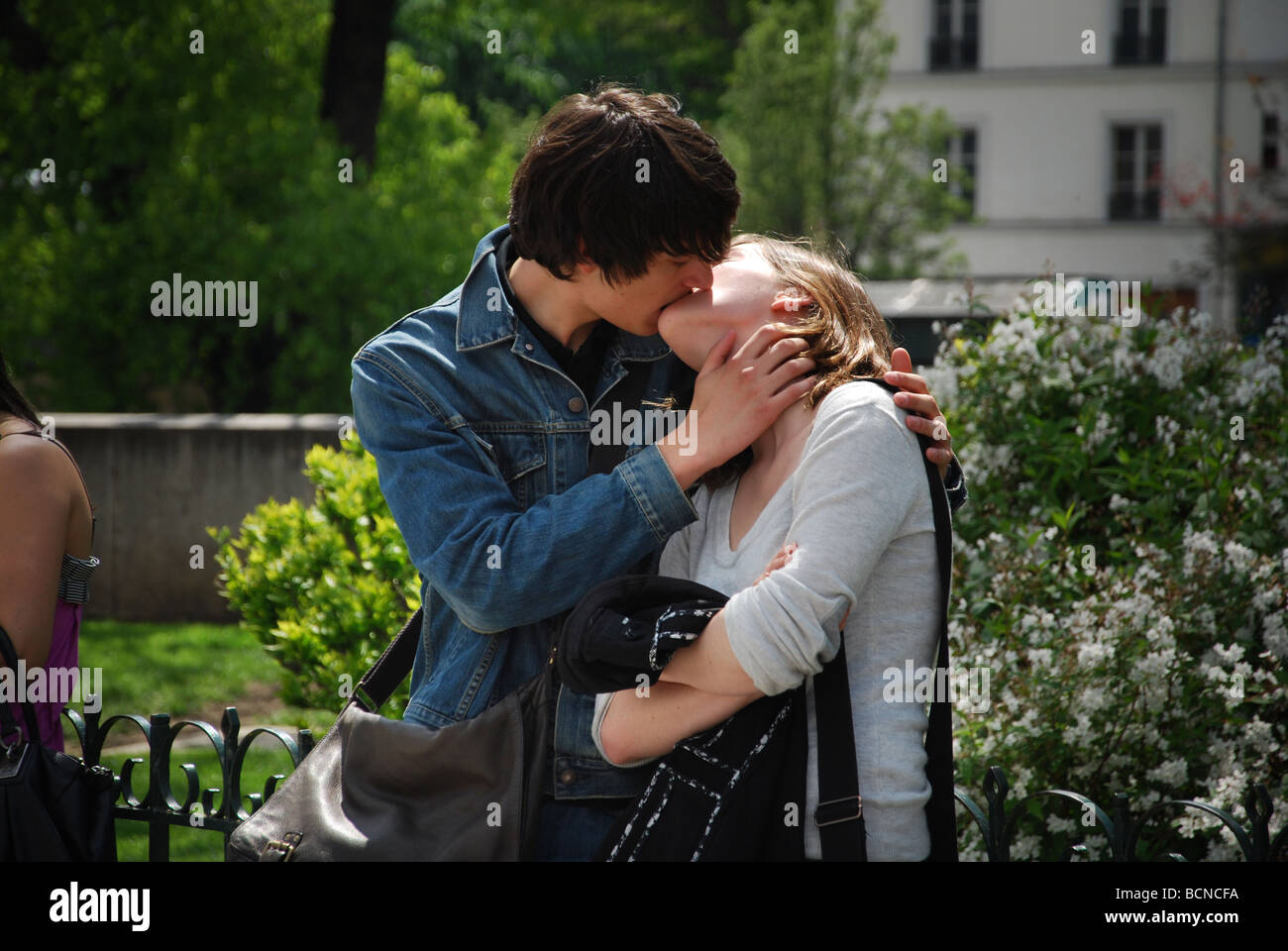 French Kiss Couple Images young french couple kissing, paris france stock photo: 25057070 - alamy