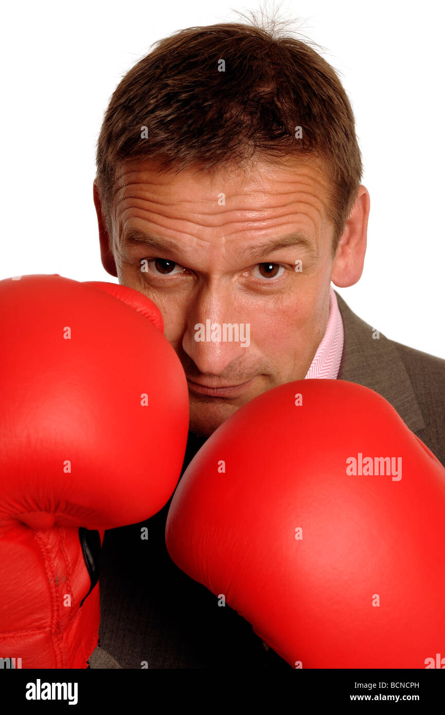 Business man with boxing gloves - Stock Image