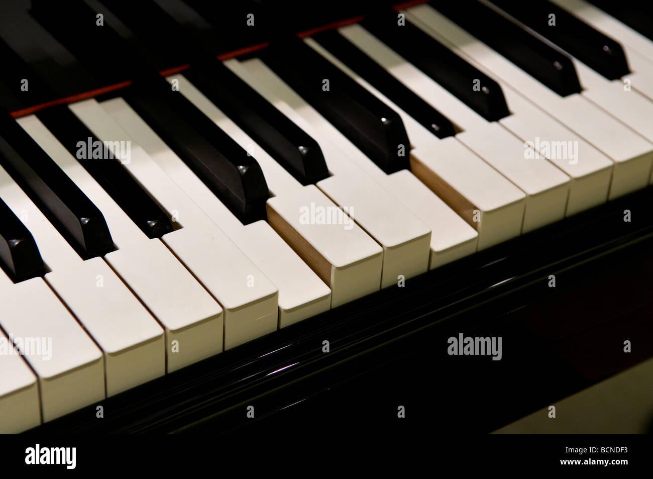 Pressed piano keyboard - Stock Image