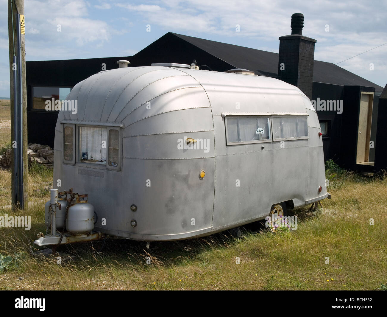 Classic vintage Airstream american trailer caravan parked at Dungeness in  Kent 2009