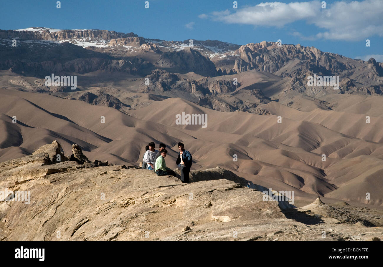 In Dragon Valley, Afghanistan's Bamiyan province, youngsters perch on the back of a monstrous myth-surrounded - Stock Image