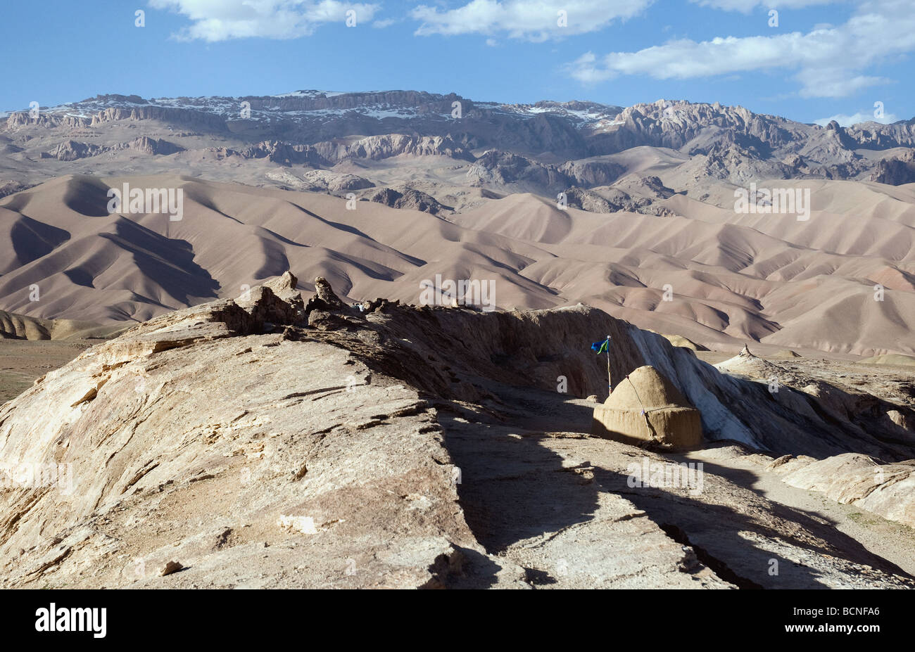 In Bamiyan's Dragon Valley a shrine {centre,right) honors Ali, the prophet Mohammed's son-in-law, for slaying - Stock Image