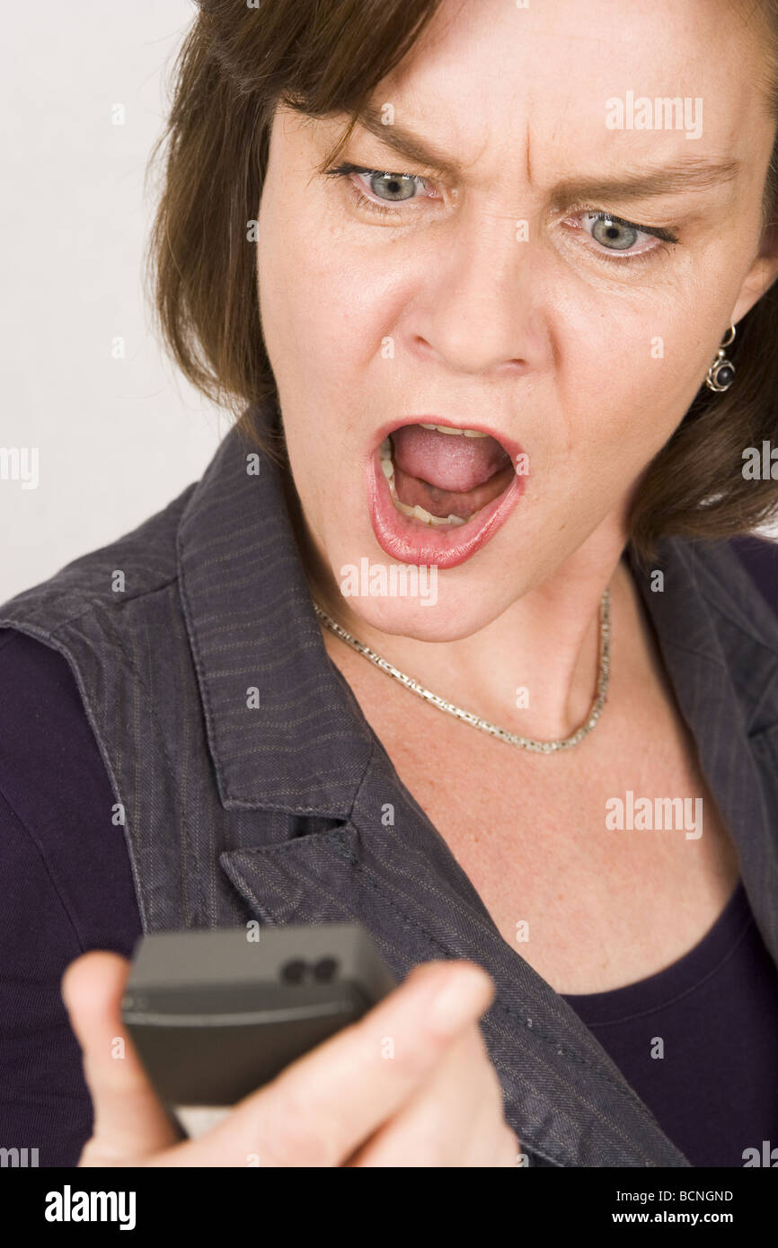 Angry woman phone call, could be stalking by  phone bully. - Stock Image