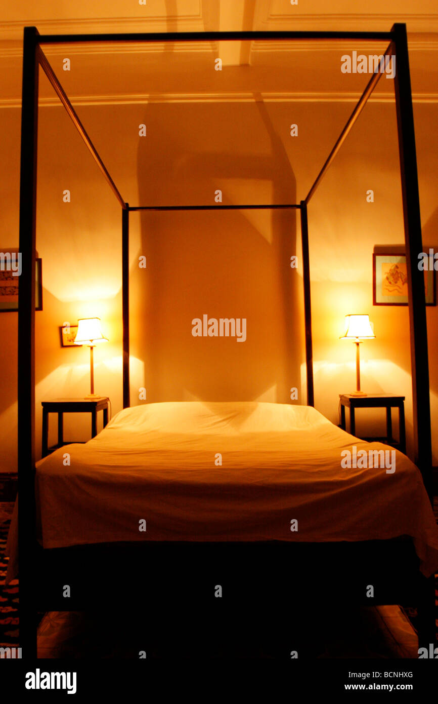 Four post bed a richly decorated guestroom in Night Lily Guest House renovated from colonial era old house, Gulangyu - Stock Image