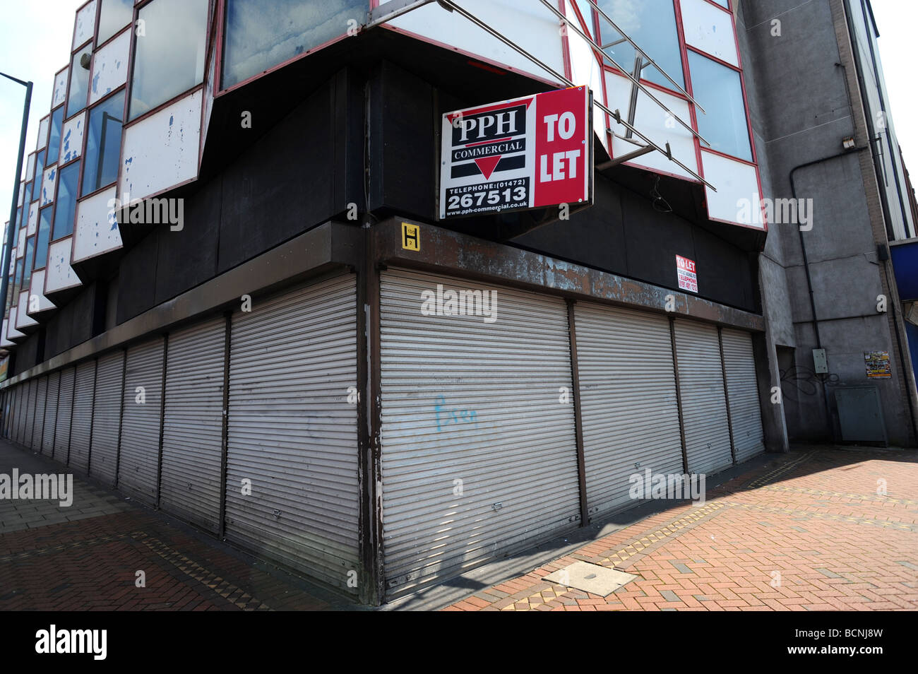 Business premises lie empty in Freeman street in Grimsby, it used to be the town's main shopping area - Stock Image