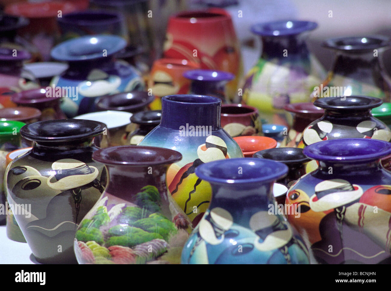 Amerindian crafts-  brightly coloured painted pottery vases, Otavlau, Ecuador - Stock Image