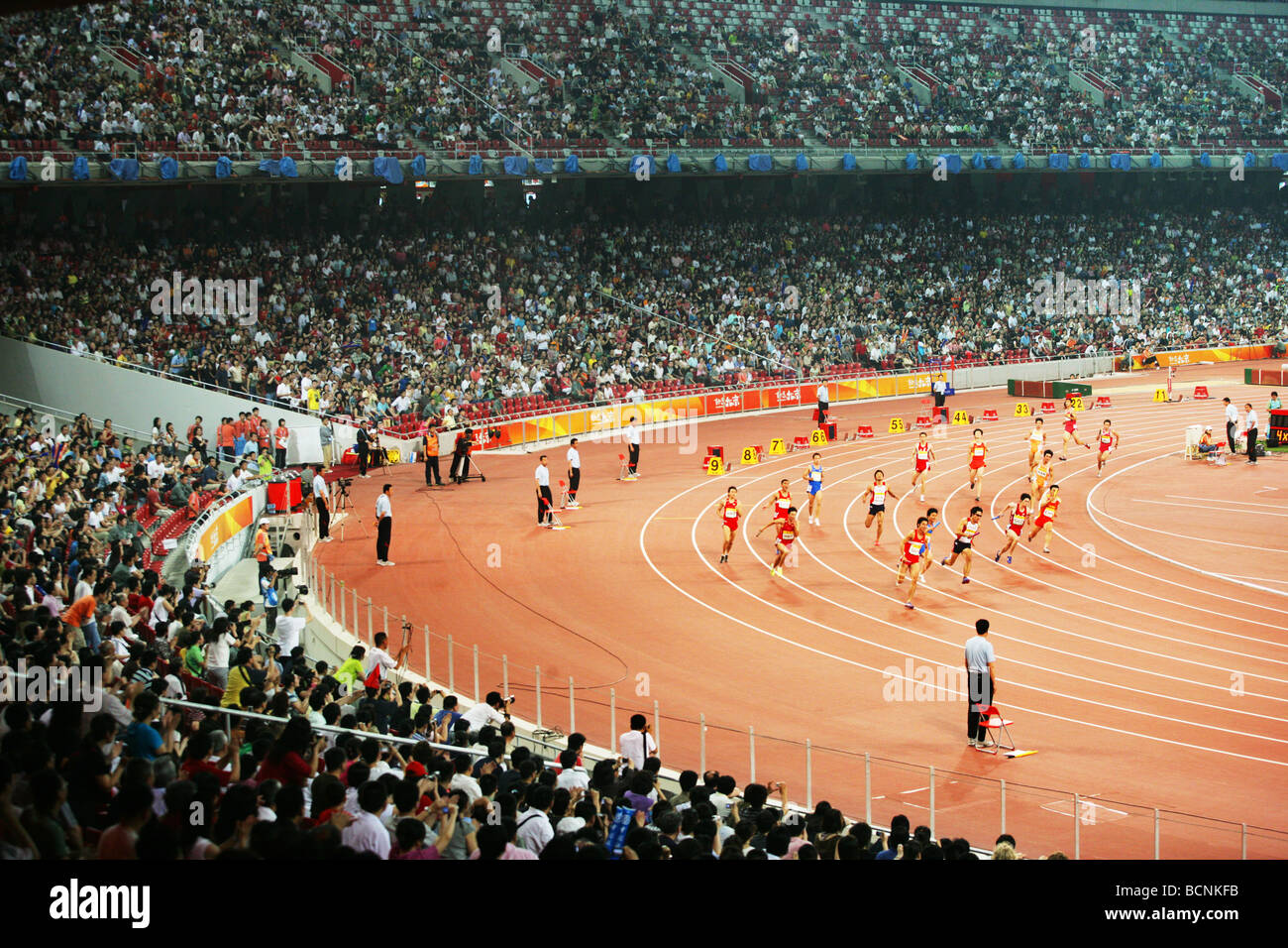 Chinese atheletes competing in 100m run during Good Luck Beijing Game held in Bird's Nest, Beijing, China