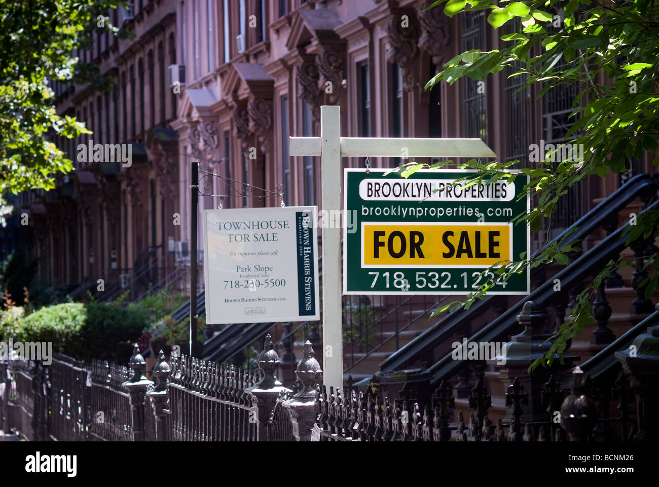 Signs for townhouses for sale in the Brooklyn neighborhood of Clinton Hill in New York on July 4 2009 Richard B - Stock Image