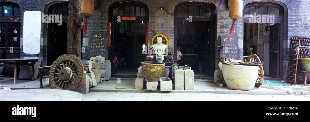 Antique store selling various relics from feudal period to recent times, Zhou Cun, Shandong Province, China - Stock Image