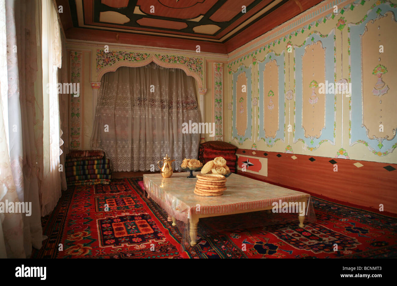 Interior of a typical Uyghur home richly decorated with carpets and drapes, Hotan, Xinjiang Uyghur Autonomous Region, - Stock Image