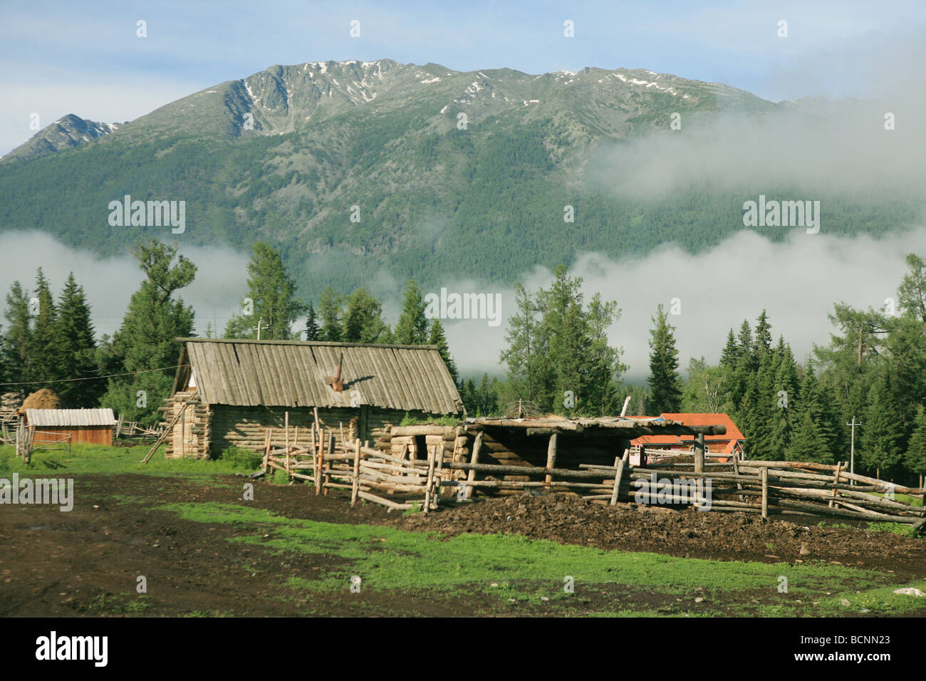 Wooden shed at the foot of hill, Kanas Conservation, Xinjiang Uyghur Autonomous Region, China - Stock Image