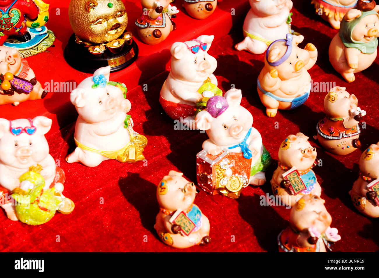 Pig shaped figurines sold during Dongyue Temple Fair during Spring Festival, Beijing, China - Stock Image
