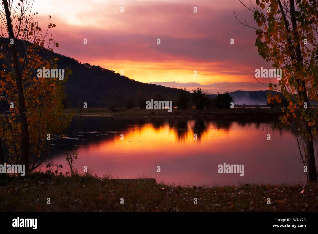 Sunset though Smoke from Burnoffs Khancoban Pondage Snowy Mountains Southern New South Wales Australia - Stock Image