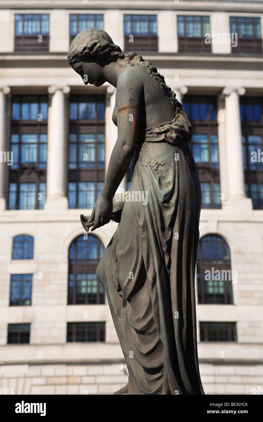 Fountain by Wills Bros with a woman sculpture  outside Unilever Headquarters 100 Victoria Embankment City of London - Stock Image