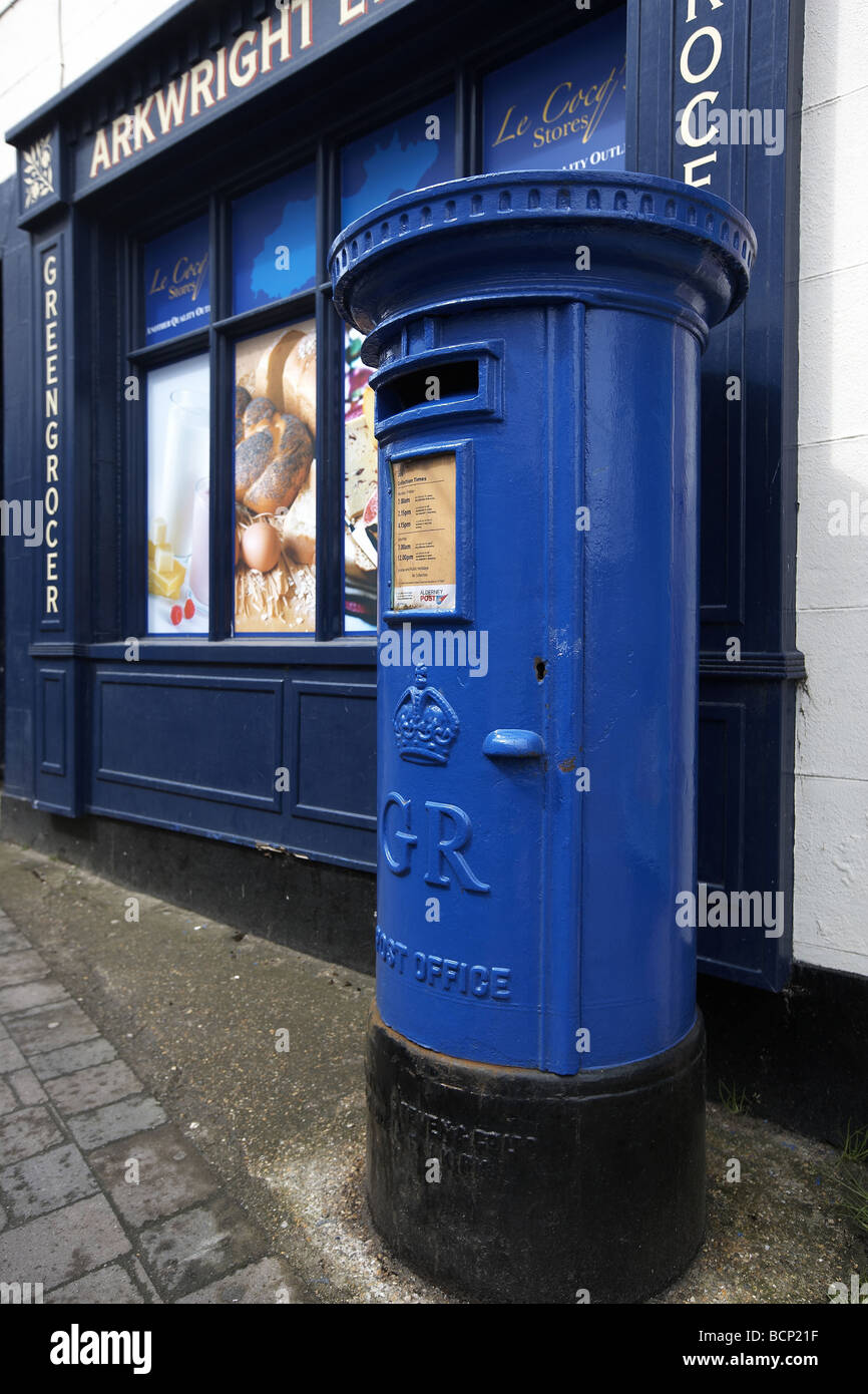 Blue post box in the main street St Anne Alderney Channel Islands UK