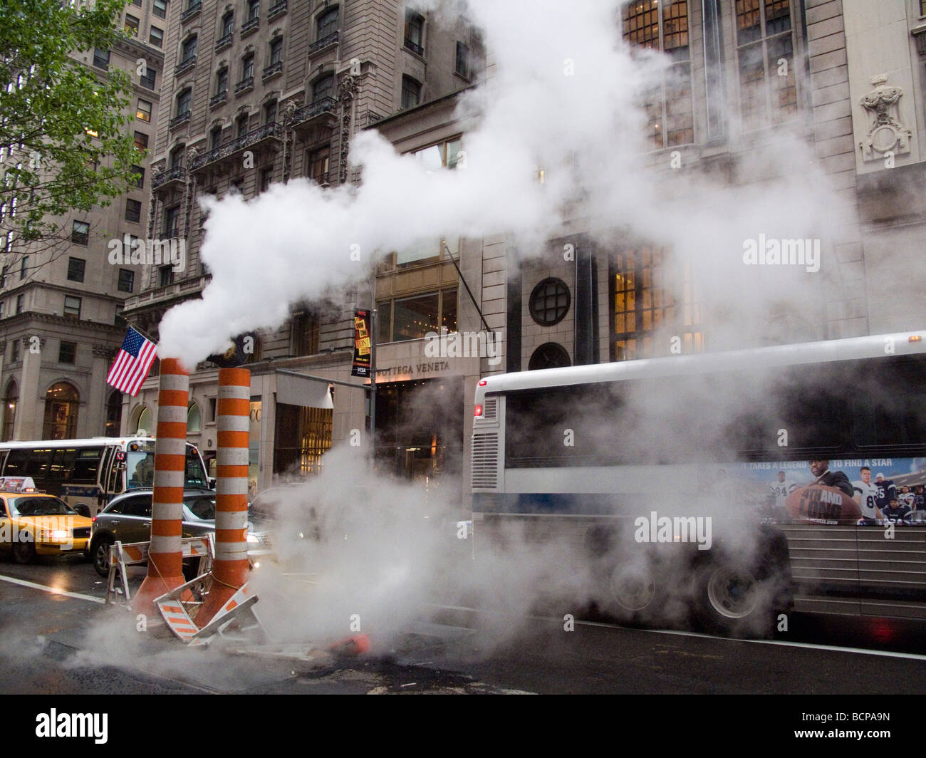 Congestion steam and weather are all part of the mix on 5th Avenue in midtown Manhattan - Stock Image