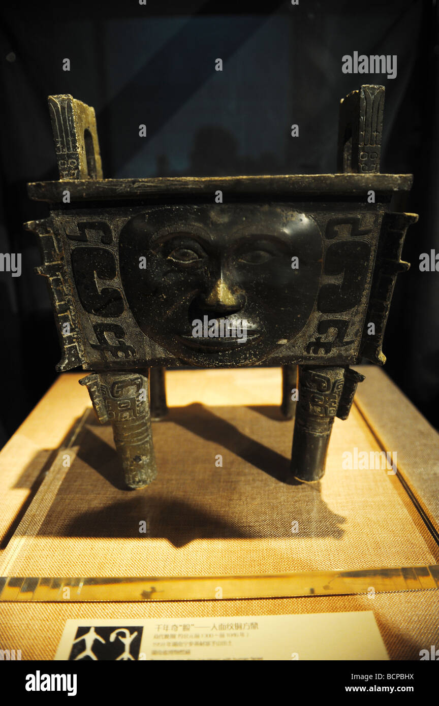 Bronze ceremonial vessel Ding with human face from late Shang Dynasty, Capital Museum, Beijing, China - Stock Image