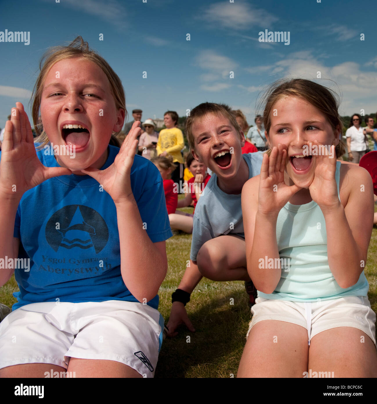 Children shouting in support of their house  team at a primary School sports day UK - Stock Image