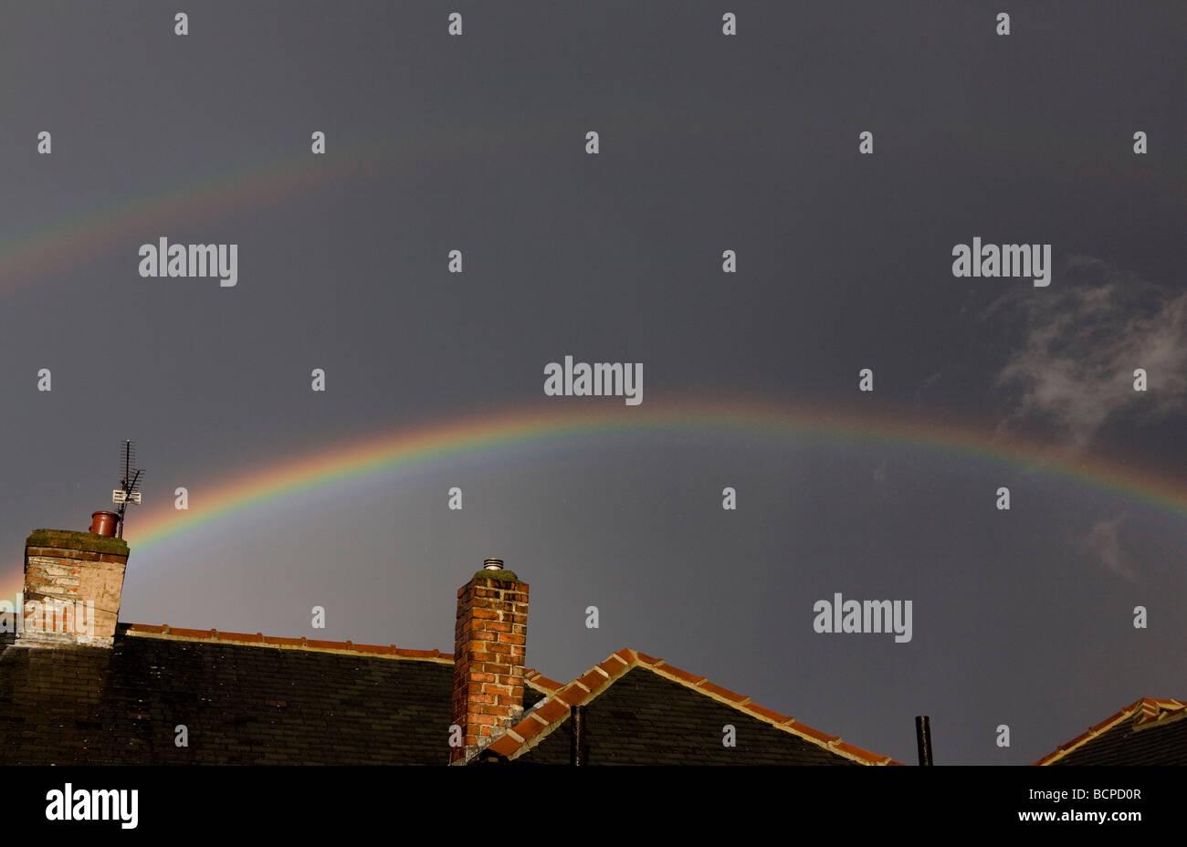 Double rainbow showing Alexandar's dark band between the arcs - Stock Image