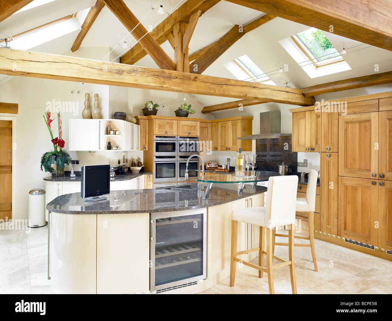 A Large Open Plan Kitchen Interior With Oak Beams