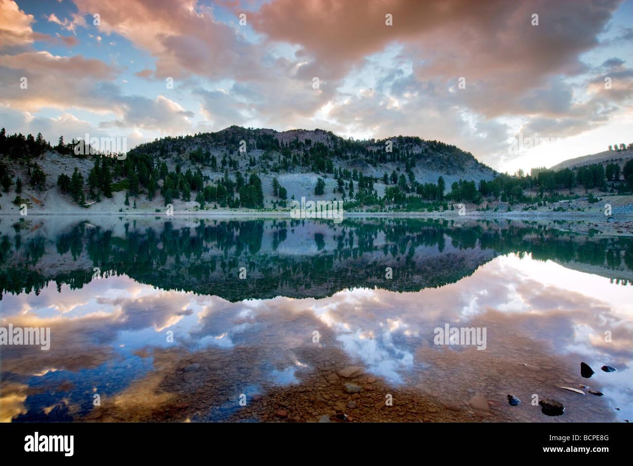 Sunrise reflected in Lake Helen Lassen Volcanic National Park California - Stock Image
