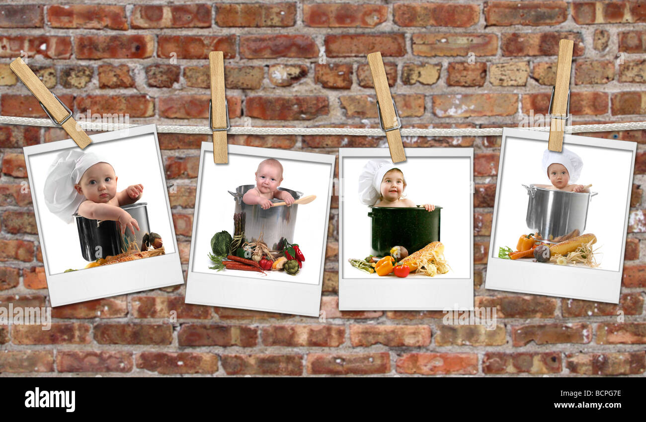 Baby Chefs in Pots Hanging on Film Blanks Against Brick Background - Stock Image