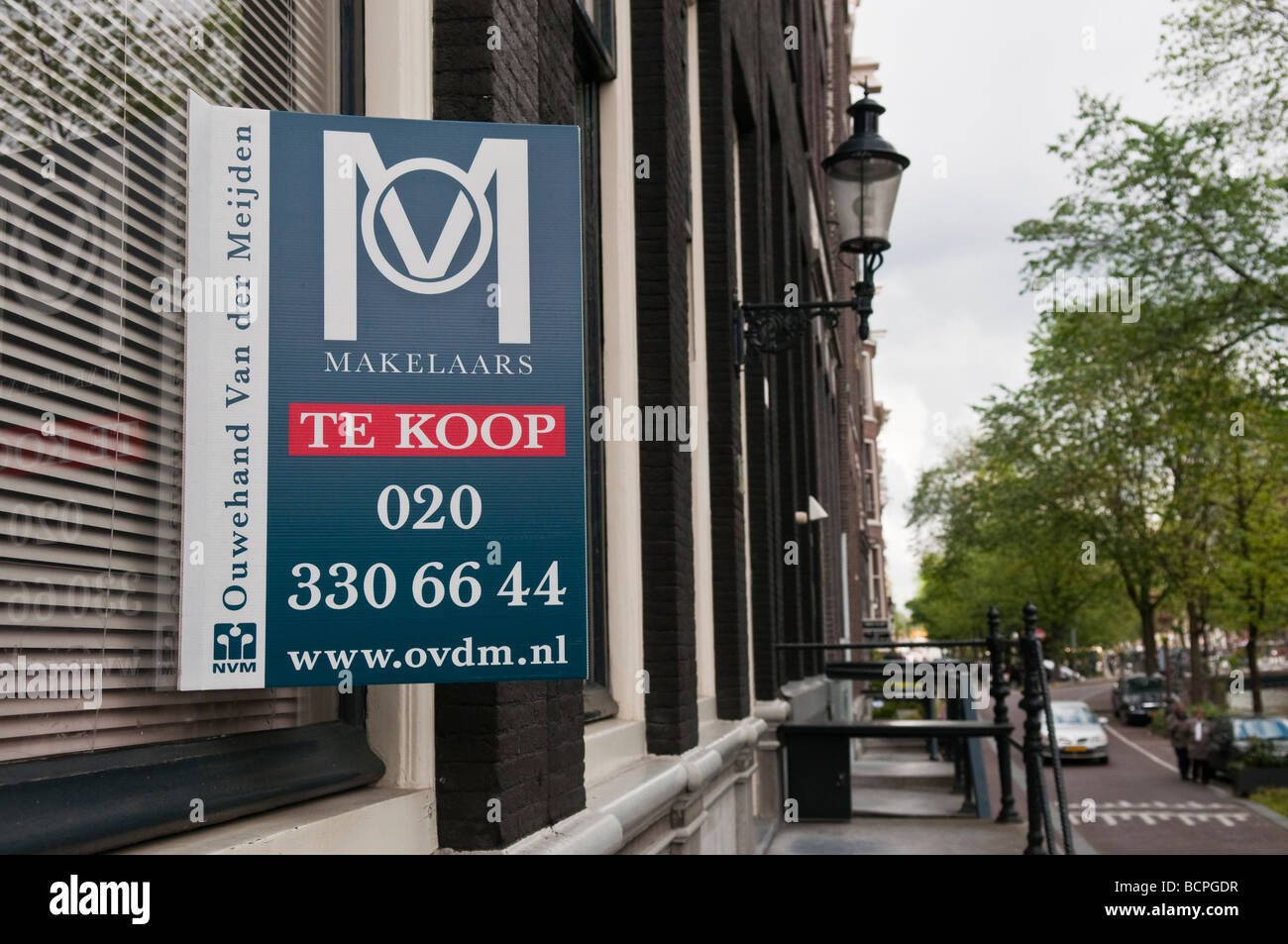 'Te Koop' (For Sale) estate agent sign on a house in an Amsterdam street. - Stock Image