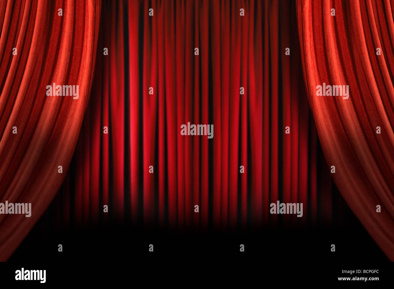 Old fashioned elegant theater stage with swag velvet curtains - Stock Image