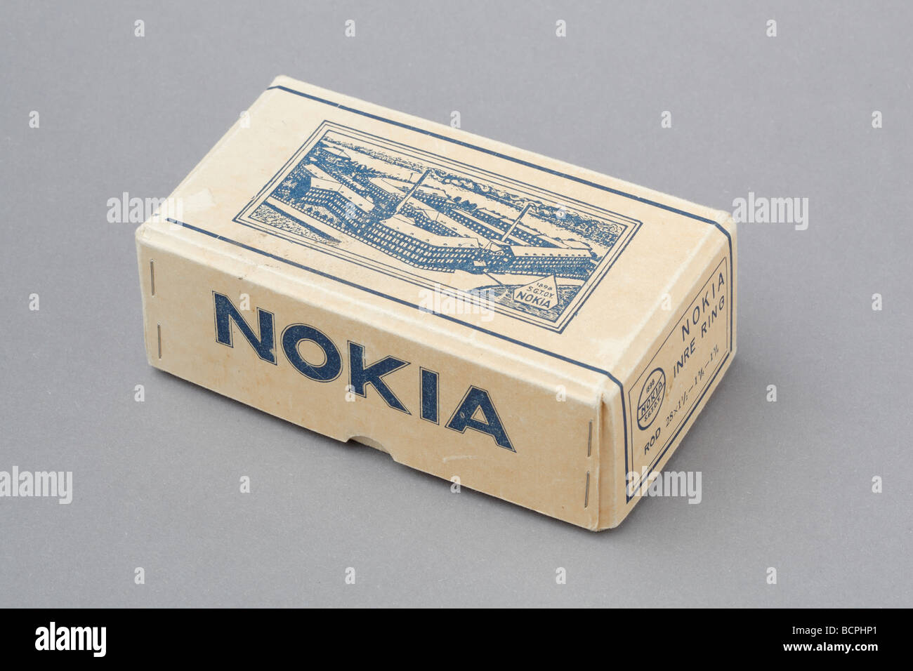 Old cardboard box, Nokia bicycle inner tube.Before becoming a major telecom company Nokia manufactured different - Stock Image