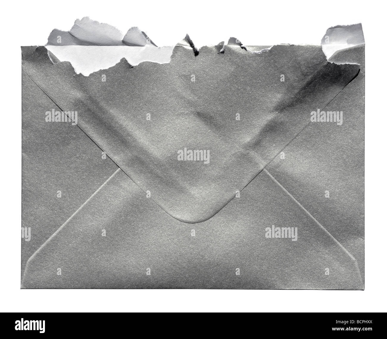 Torn open silver envelope - Stock Image