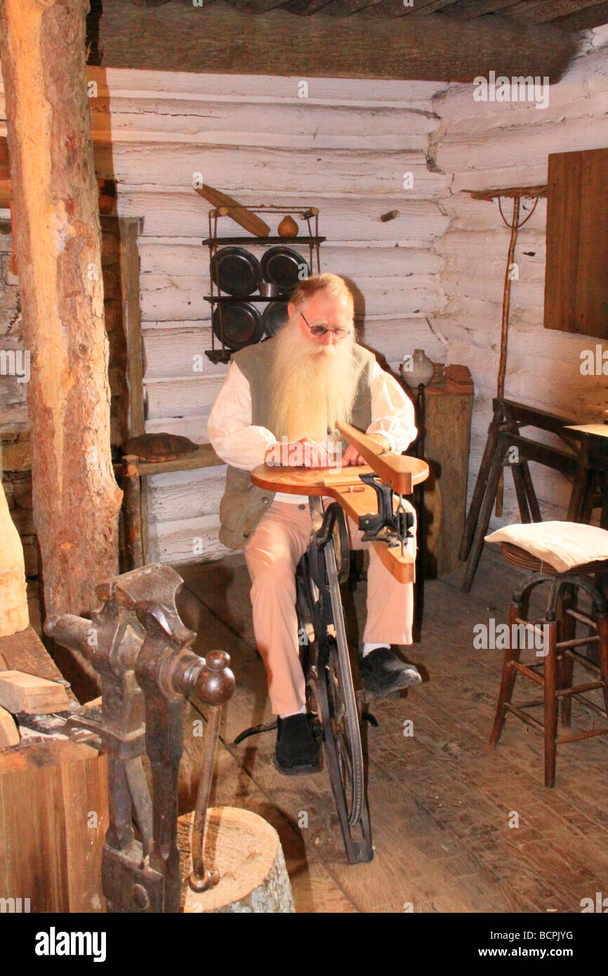 Woodworker uses an early jigsaw at Old Fort Harrod State Park Harrodsburg Kentucky Stock Photo