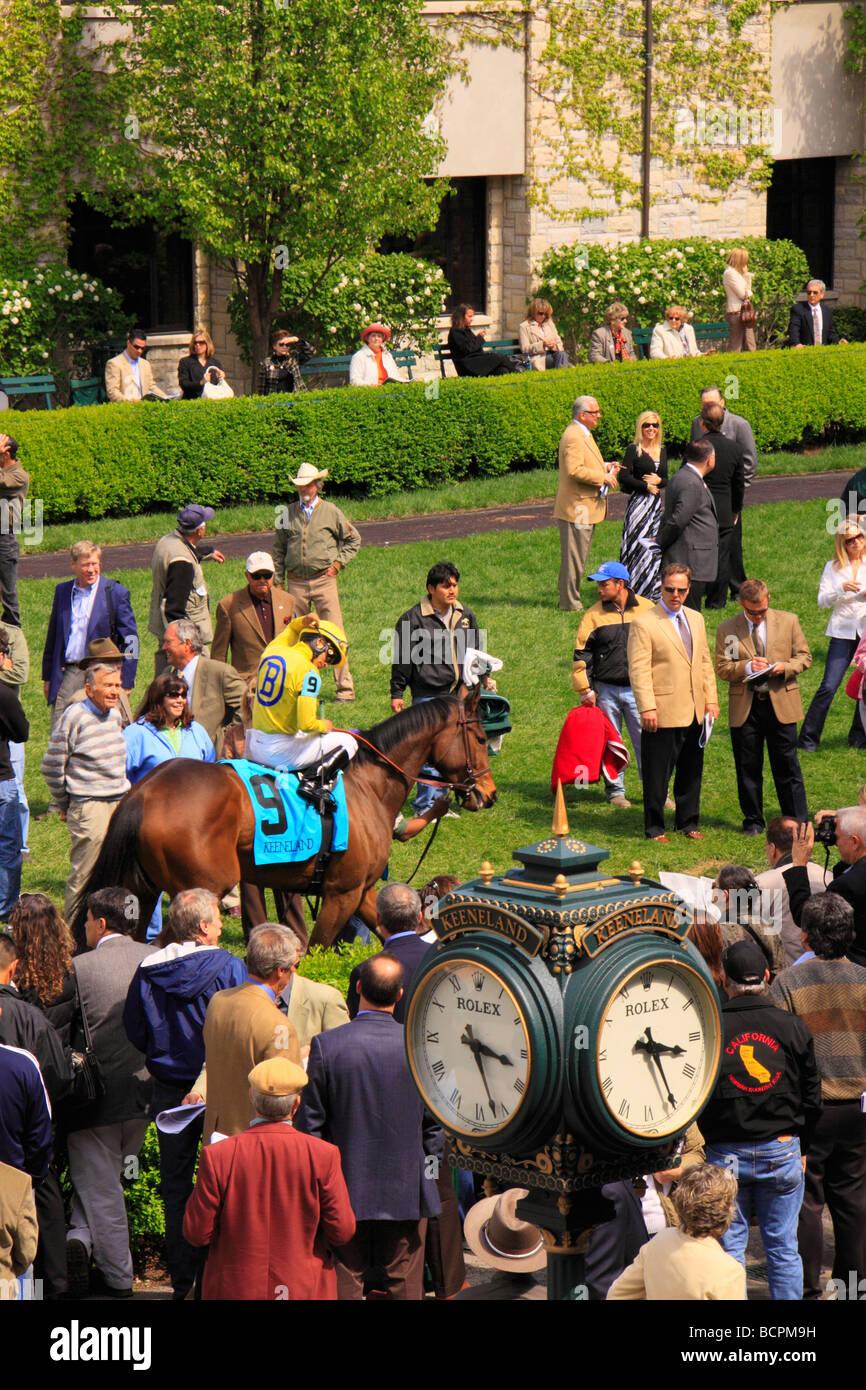 Spectators watch jockeys mount up in the paddock before a race Keeneland Race Course Lexington Kentucky Stock Photo