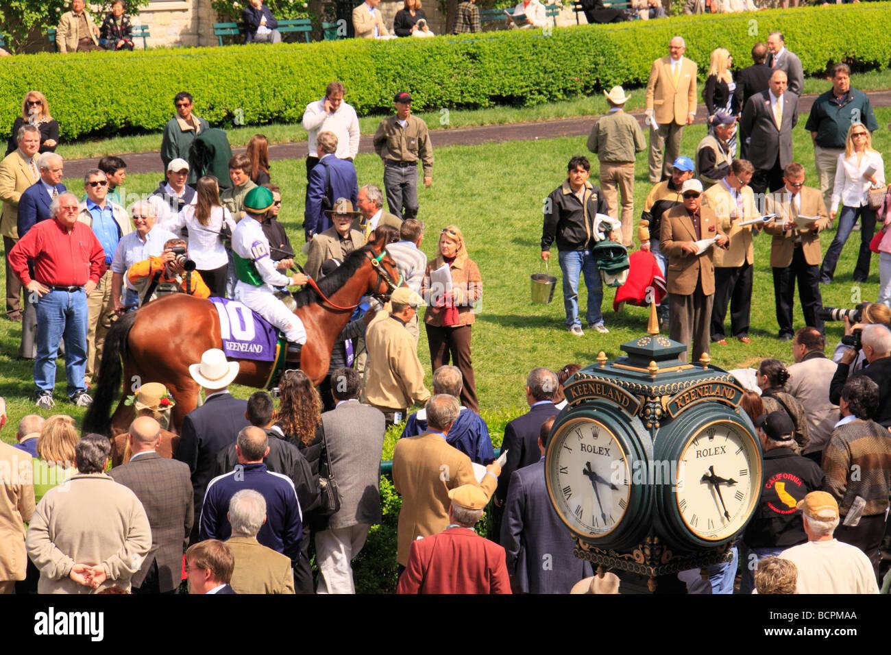 Spectators watch jockeys mount up in the paddock before a race Keeneland Race Course Lexington Kentucky - Stock Image