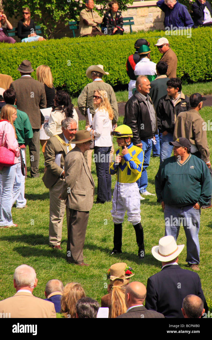 Jockeys talk with owners and trainers in the paddock before a race Keeneland Race Course Lexington Kentucky - Stock Image