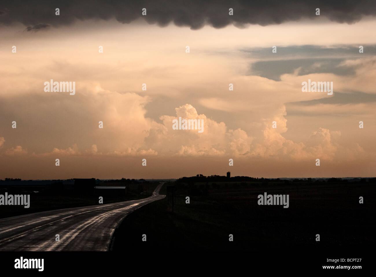 Thunderstorms fire in the distance at sunset near Fairbury Nebraska USA June 1 2009 - Stock Image